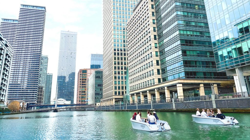 Image shows two GoBoats sailing in Canary Wharf