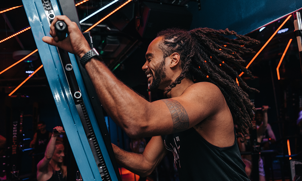 Working the Versaclimber at Sweat By BXR