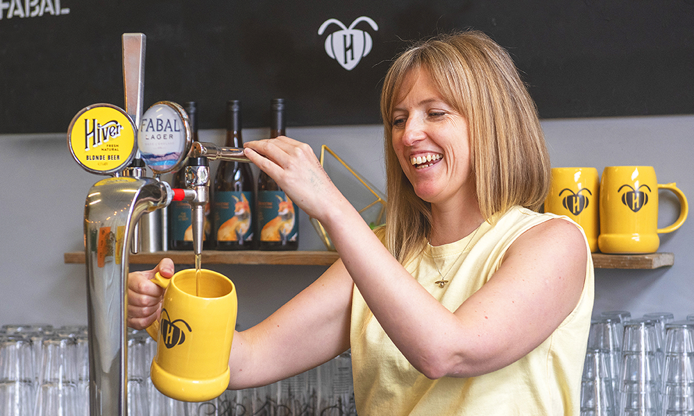 Hannah pours a Phoebee stein of beer